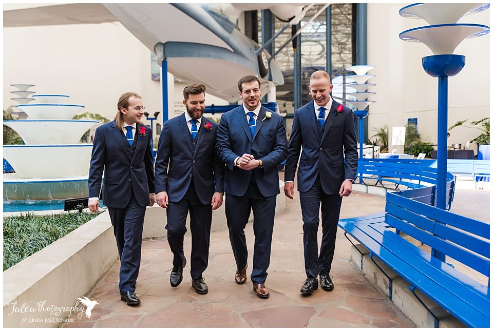 groom groomsmen walking together before wedding ceremony