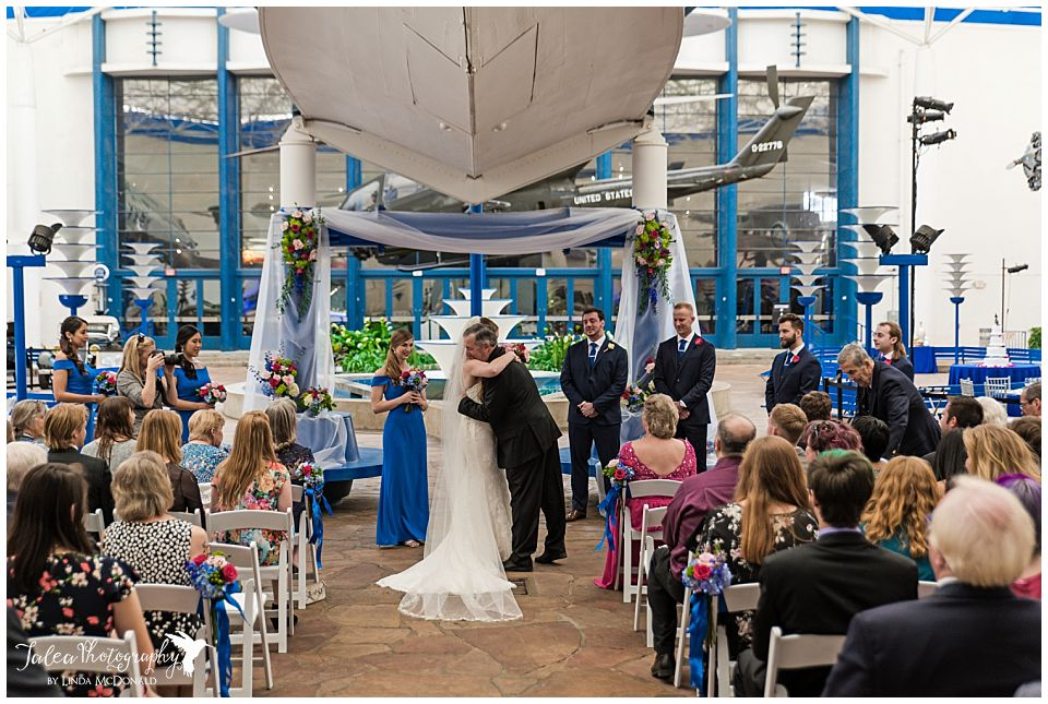 bride and father hugging at air space museum wedding ceremony