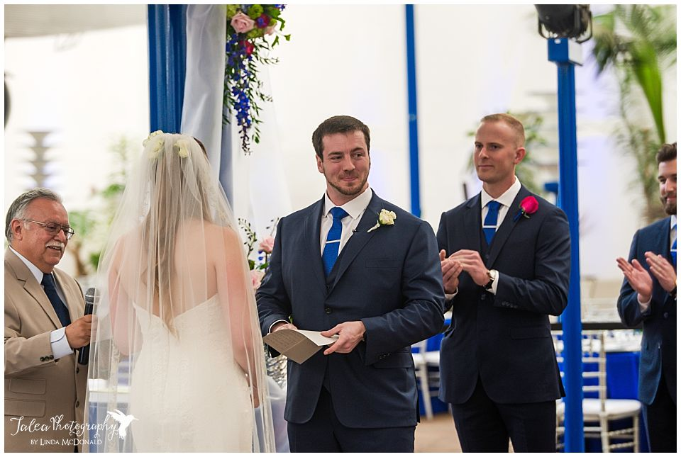 groom smiling at guests before saying vows