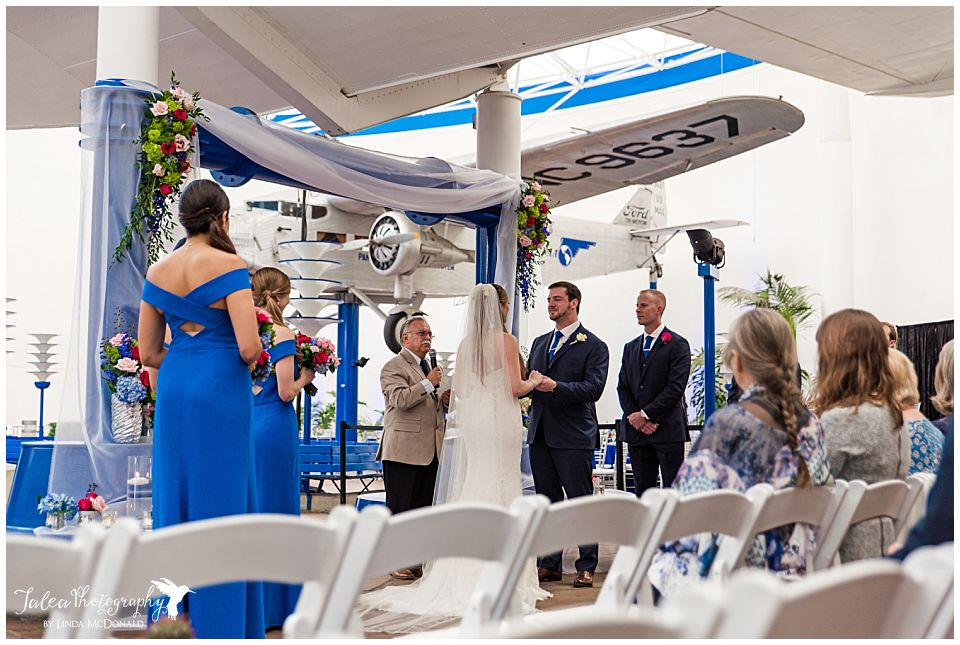 wedding ceremony underneath airplane at san diego air space museum