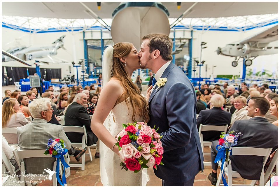 bride groom recessional kiss san diego air space museum wedding photos