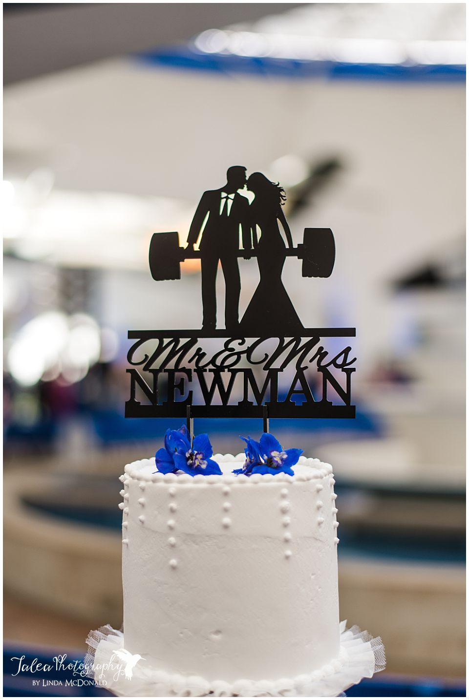 wedding cake topper bride groom lifting weight