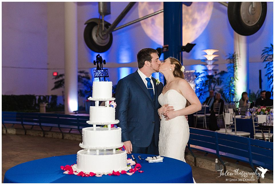bride groom cake cutting san diego air space museum wedding photos