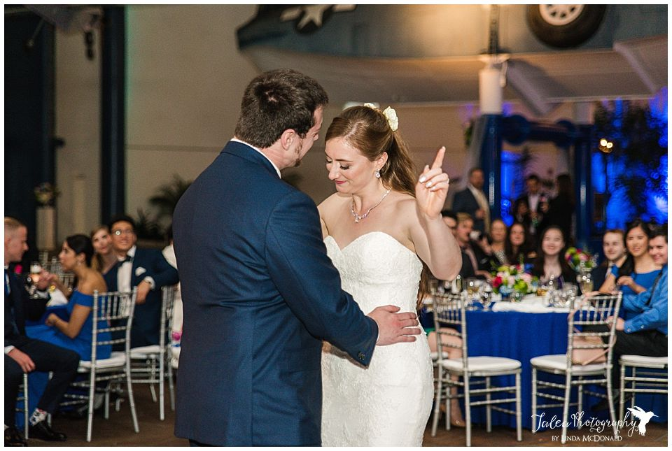 bride and groom dancing together at reception