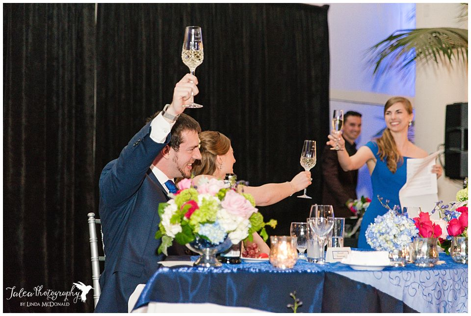 bride groom toasting maid of honor