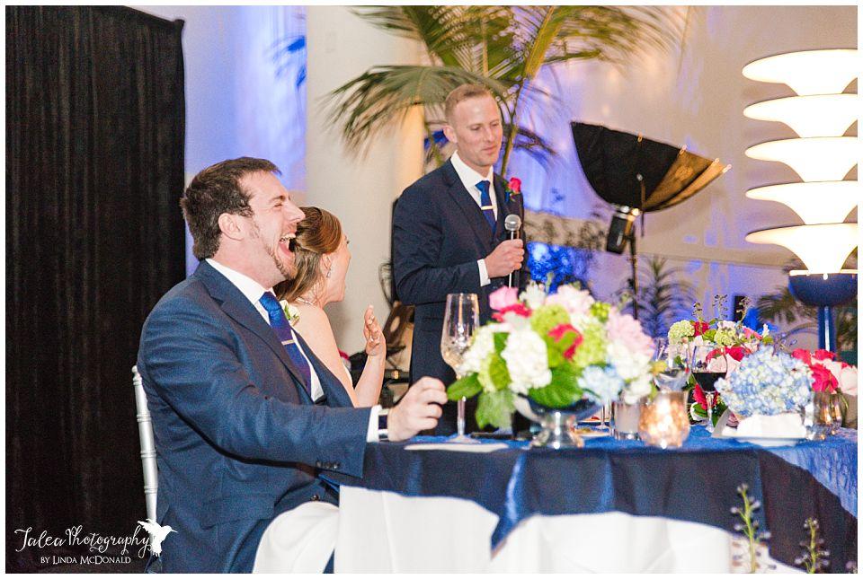 groom laughing during best man speech
