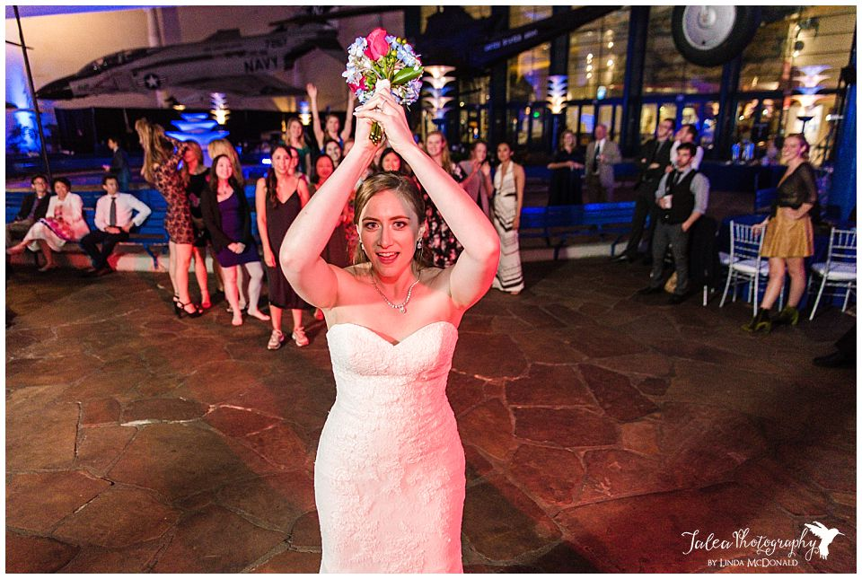 front view of bride tossing bouquet