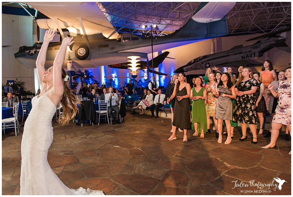 bride about to toss bouquet at wedding reception