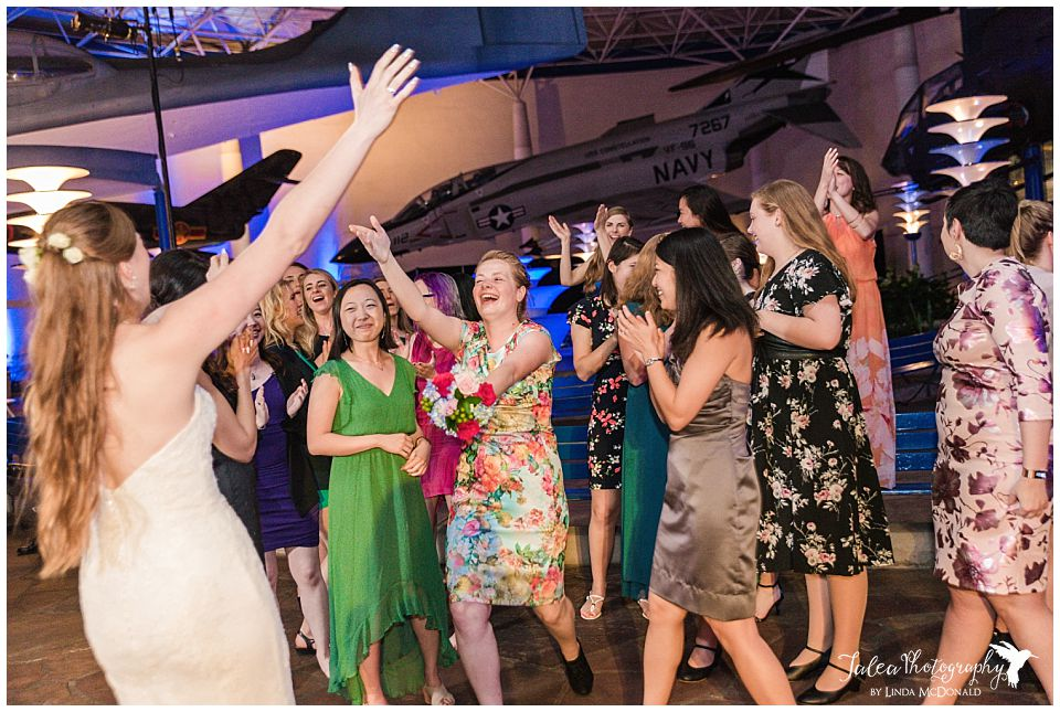 reception guest approaching bride after bouquet toss