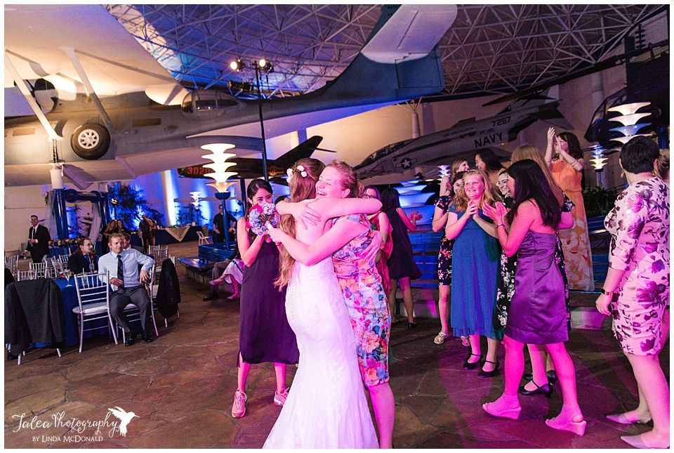 bride hugging guest after bouquet toss
