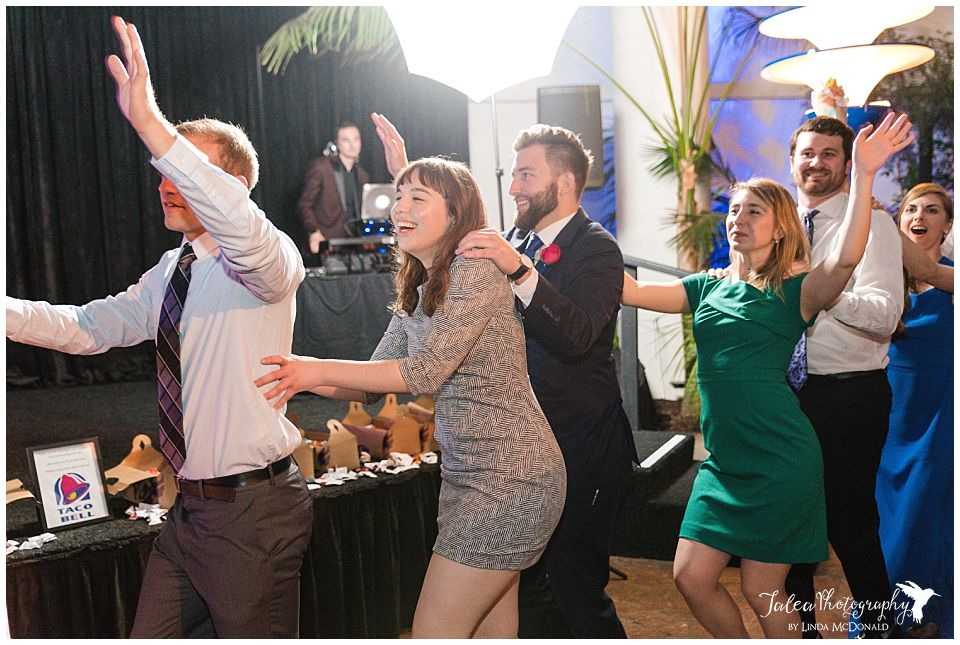 guest dancing in a line at wedding reception