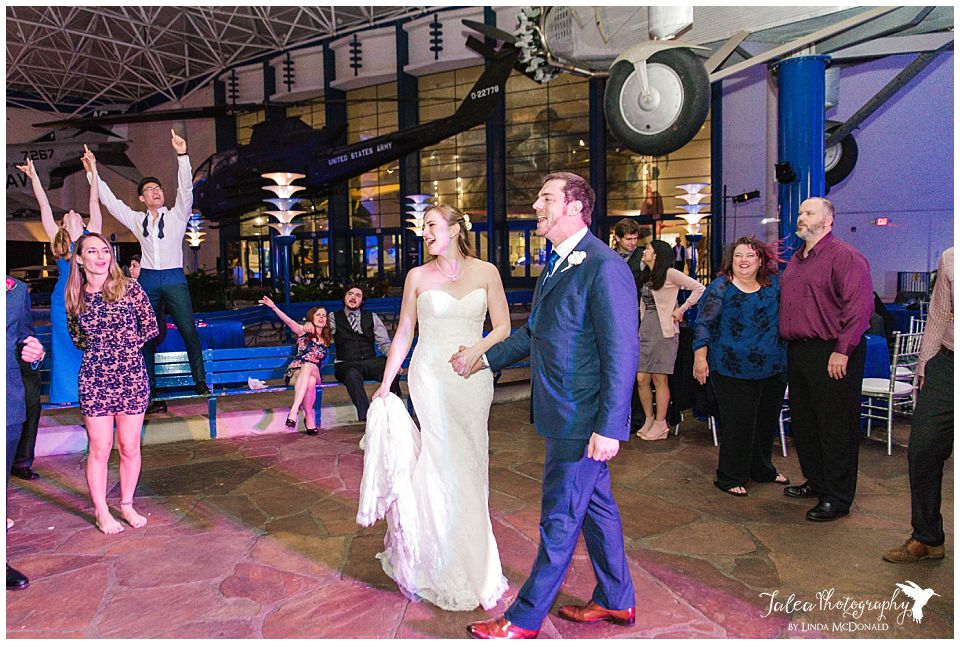 bride groom surrounded by guest on dance floor