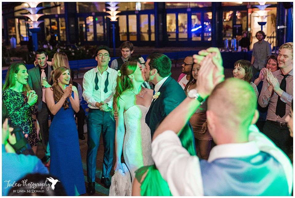 bride groom kissing middle of dance floor