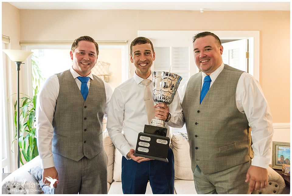 groom-posing-with-trophy