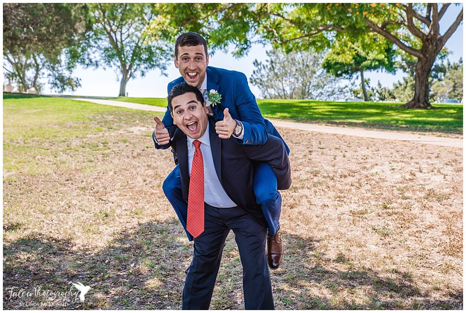 groom-on-groomsmens-back-fun-pose