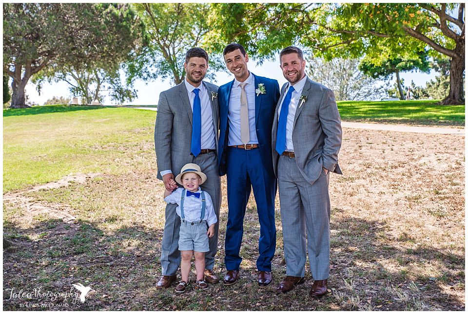 groom-posing-with-groomsmen-ring-bearer
