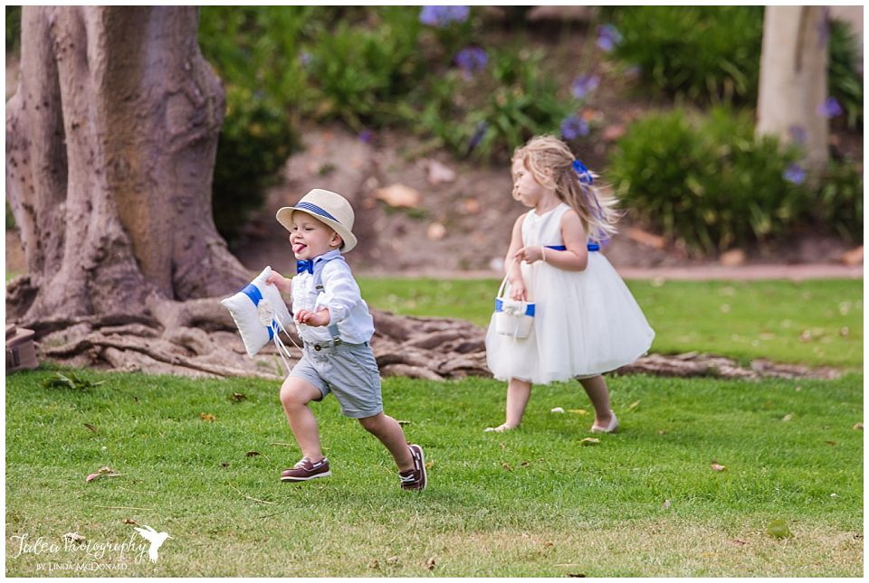 ring-bearer-running-on-grass-to-alter