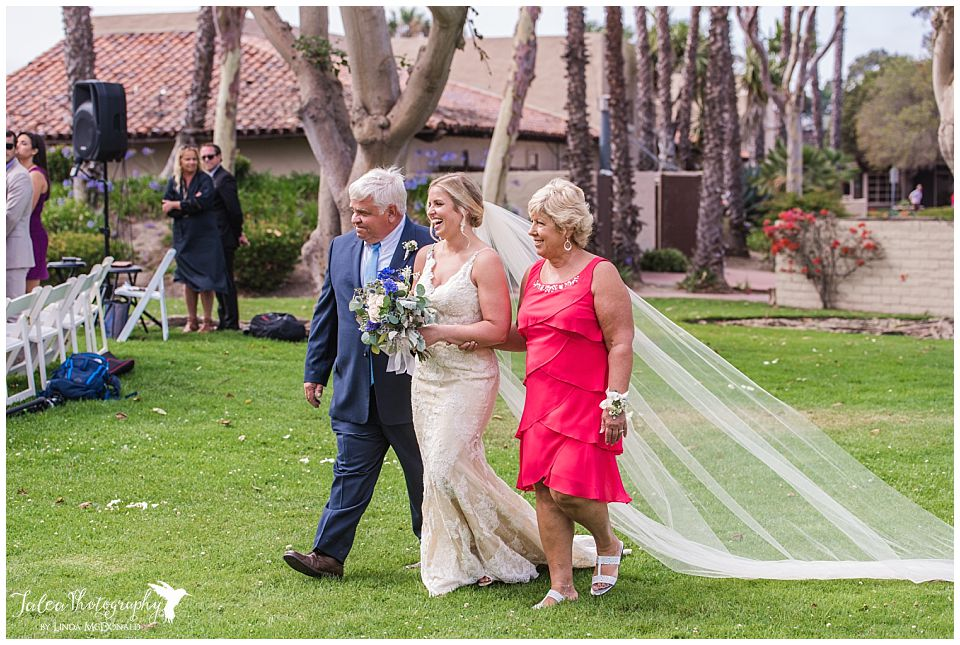 bride-walking-towards-aisle-with-mom-dad