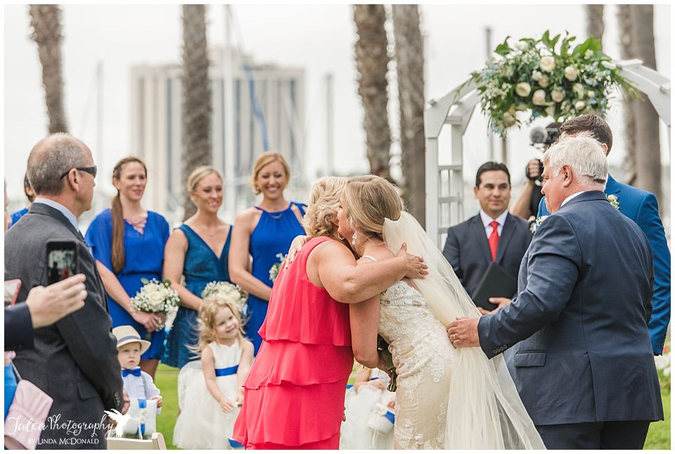 bride-hugging-her-mother-during-wedding-ceremony