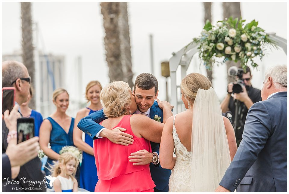 groom-hugging-mother-of-bride