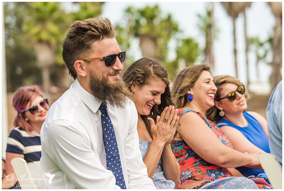 guests-laughing-during-wedding-ceremony