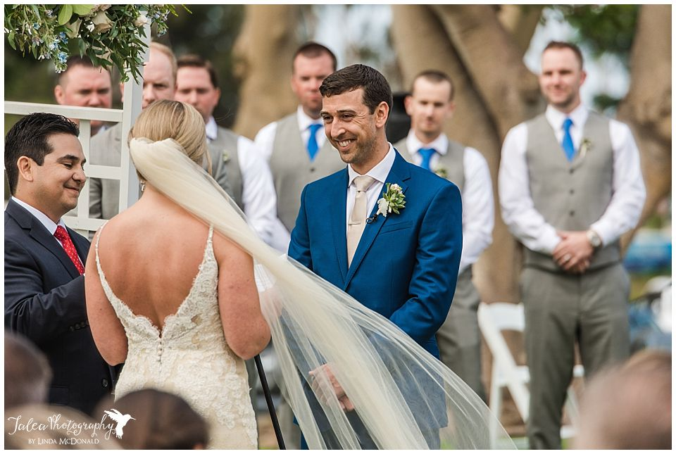 groom-listening-to-brides-speech-during-ceremony