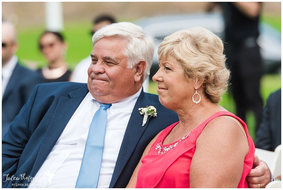 brides-parents-smiling-during-ceremony