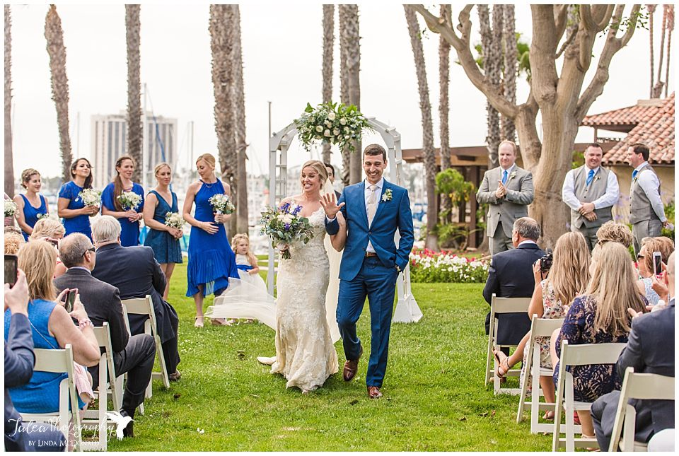 bride-looking-excited-at-recessional-marina-village-wedding