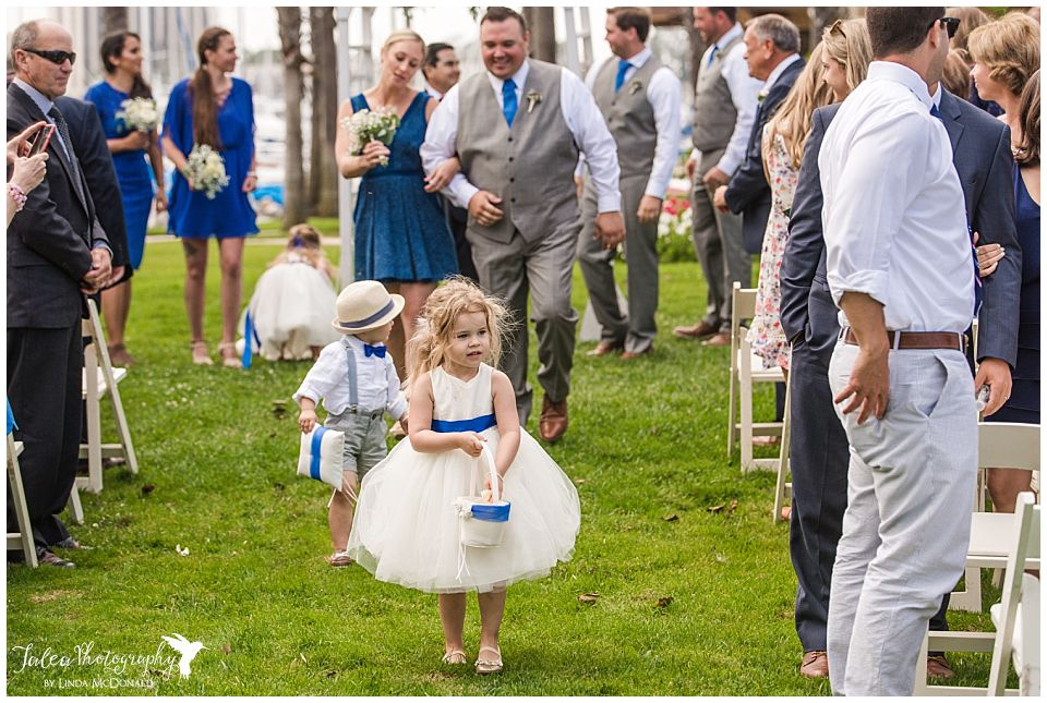 flower-girl-walking-down-aisle-at-recessional