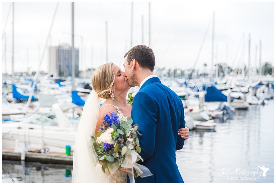 romantic-image-bride-groom-kissing-on-boat-dock