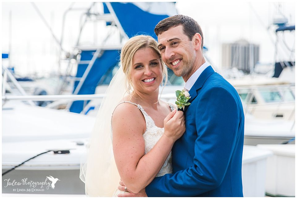 bride-looking at-camera-while-standing-on-boat-dock
