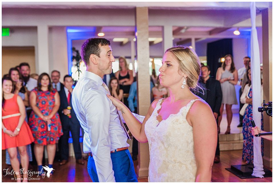 bride-groom-getting-down-for-first-dance-marina-village-wedding