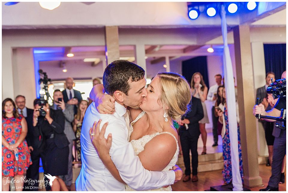 bride-groom-kissing-during-first-dance