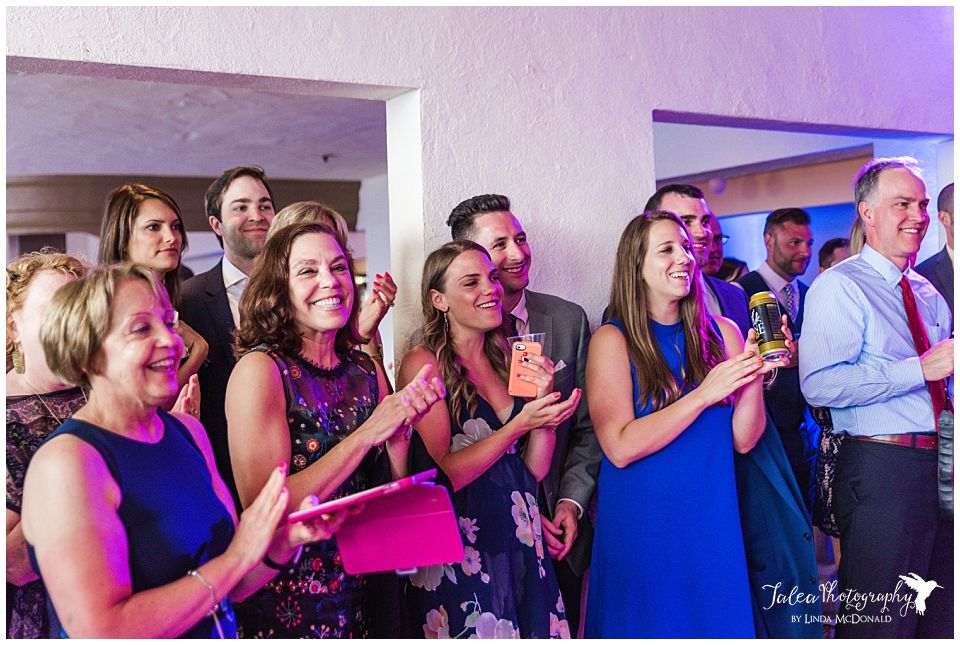wedding-guests-clapping-at-reception