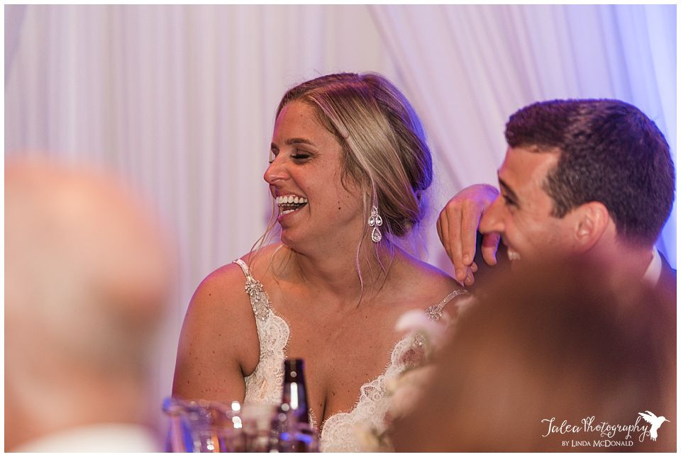 bride-laughing-during-reception-toast