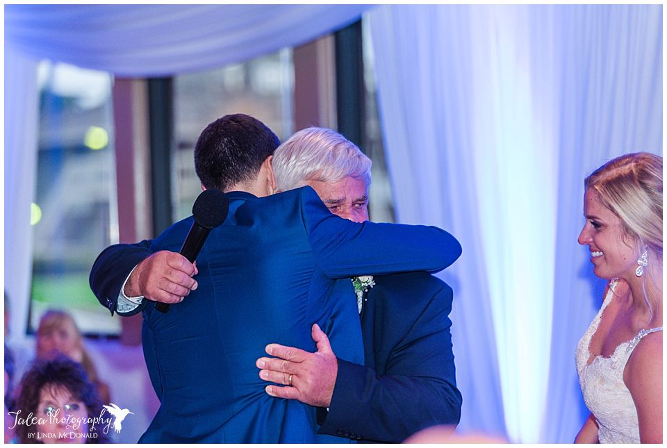 groom-and-father-in-law-hugging