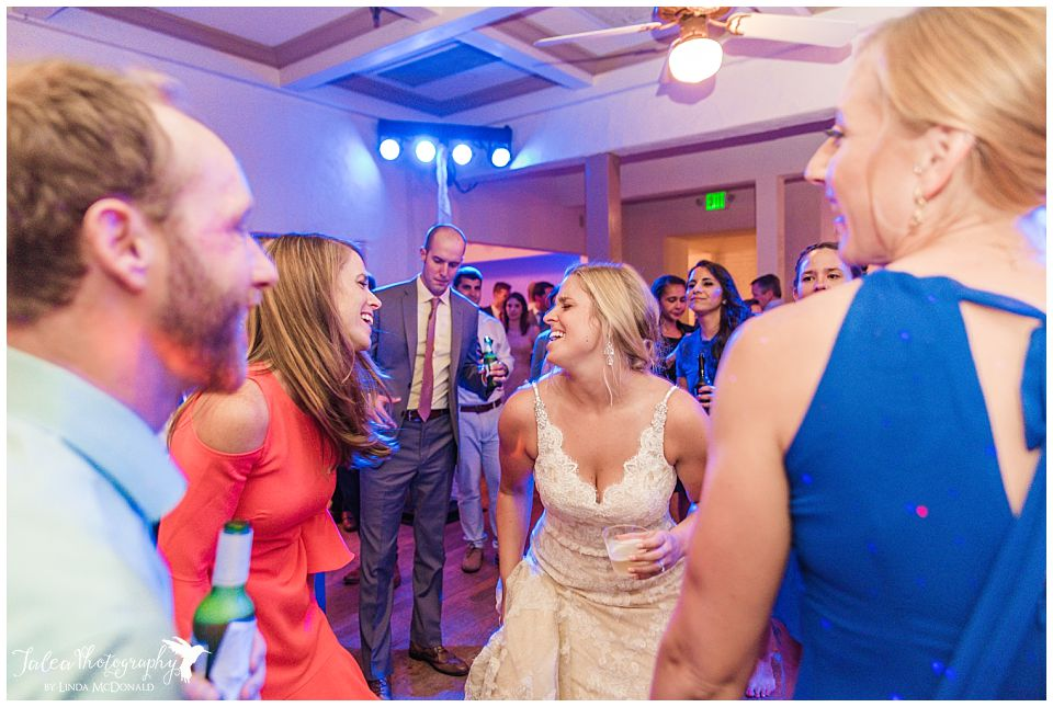 bride-singing-on-dance-floor-with-guest