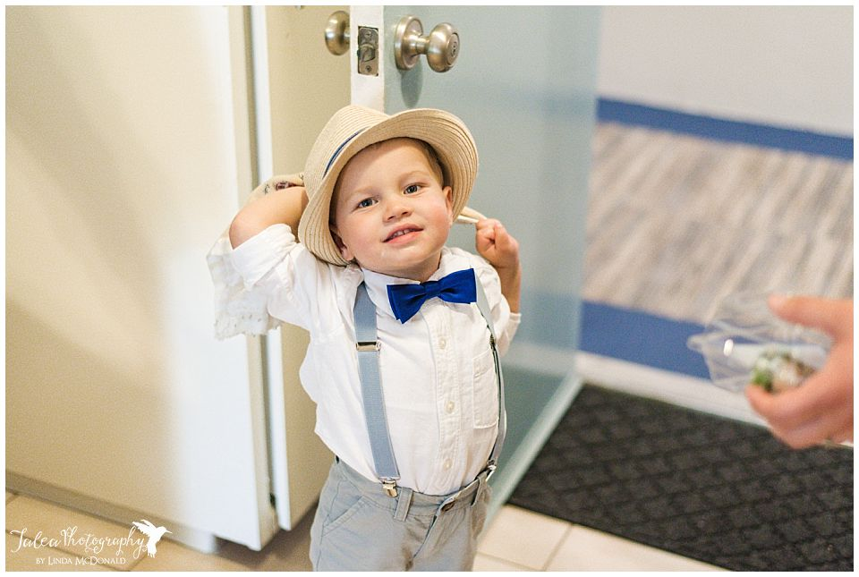 ring-bearer-hanging-out-beside-apartment-door