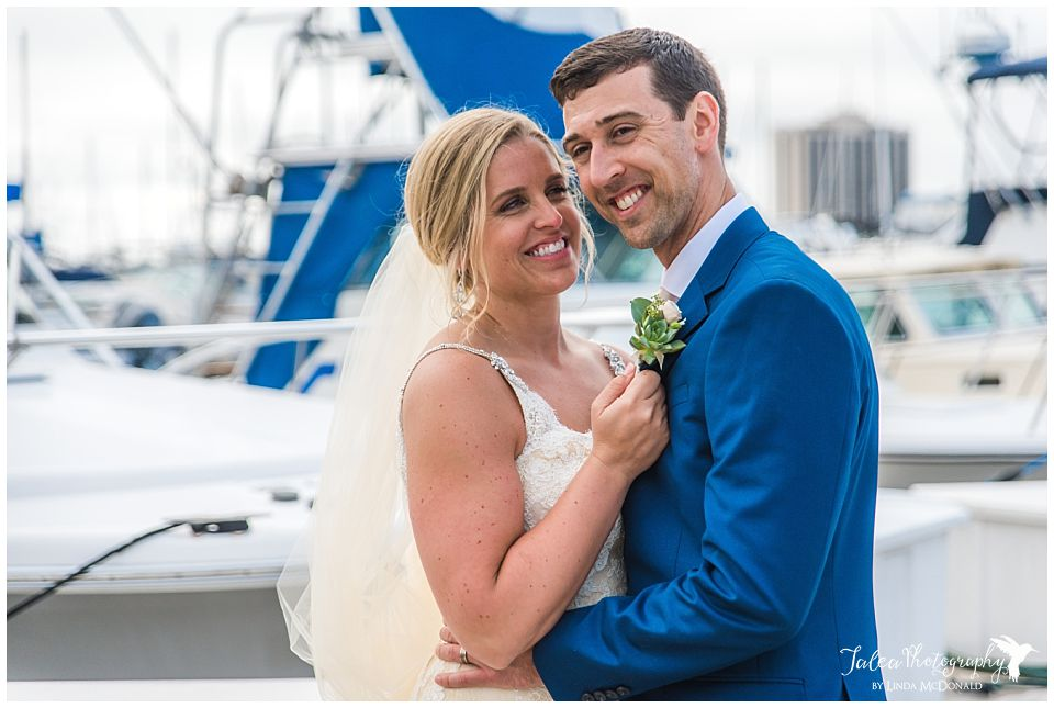 couple-in-an-embrace-at-san-diego-marina
