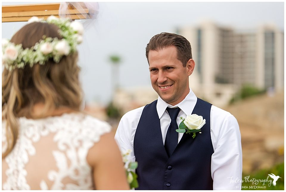 groom-looking-at-bride-wedding-ceremony-cuvier-park-la-jolla