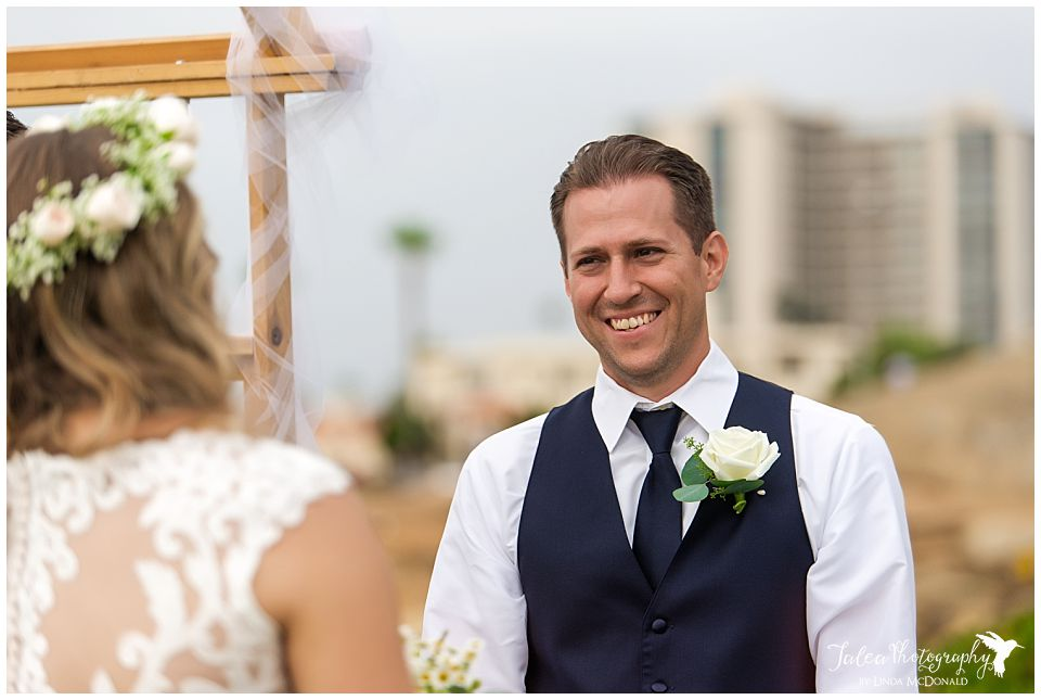 groom laughing during cremony at wedding bowl la jolla