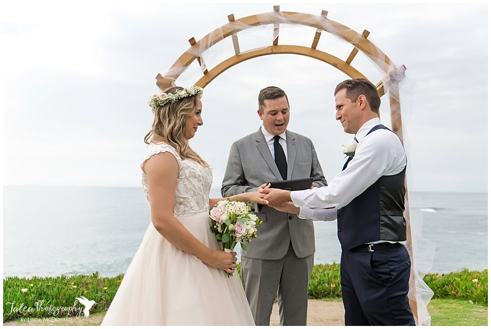 groom-putting-ring-on-brides-finger-wedding-bowl-la-jolla