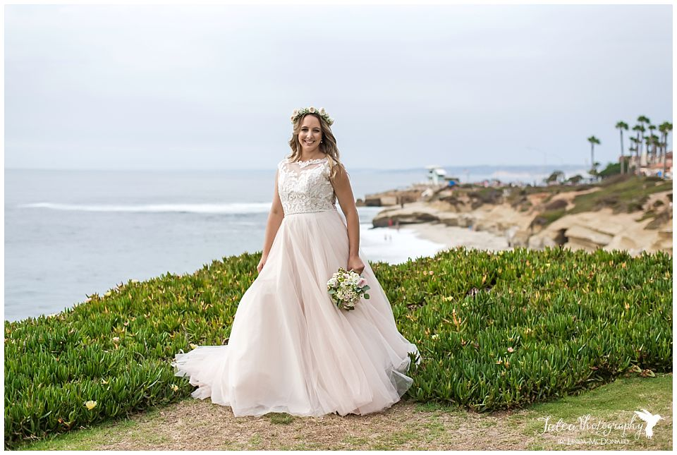 bride in pink wedding dress overlooking la jolla beach san diego