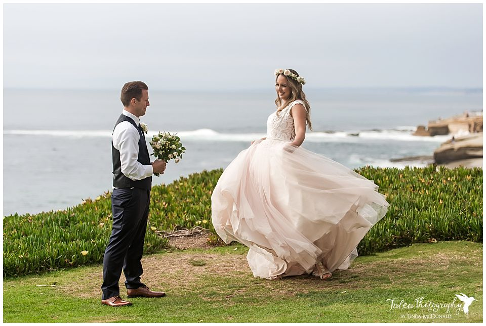bride-twirling-dress-groom-watching-cuvier-park-la-jolla