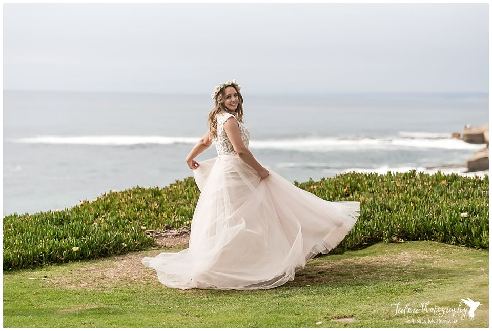 bride-in-ballroom-gown-twirling-in-dress-cuvier-park-la-jolla