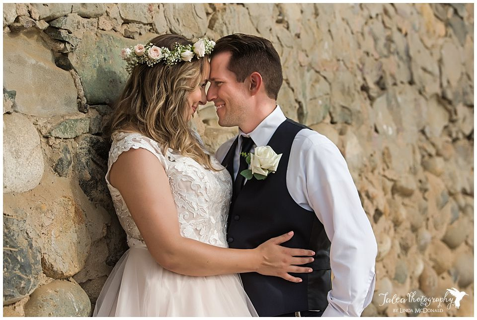 newlyweds forehead to forehead smiling at each other wedding bowl la jolla