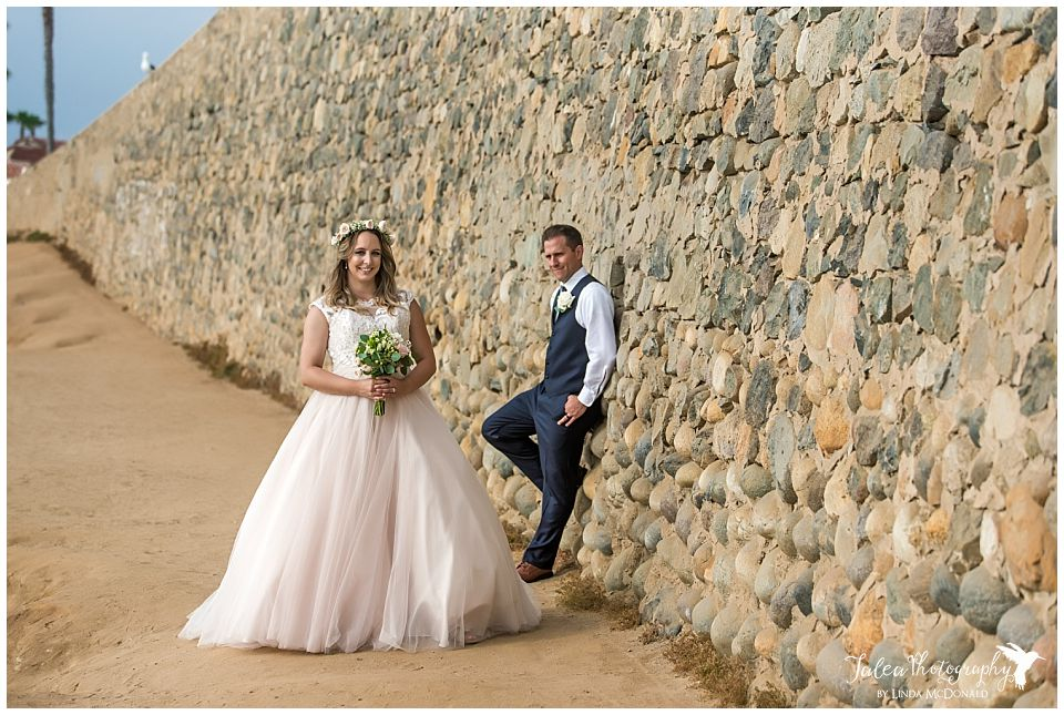bride-groom-posing-by-wall-wedding-bowl-la-jolla