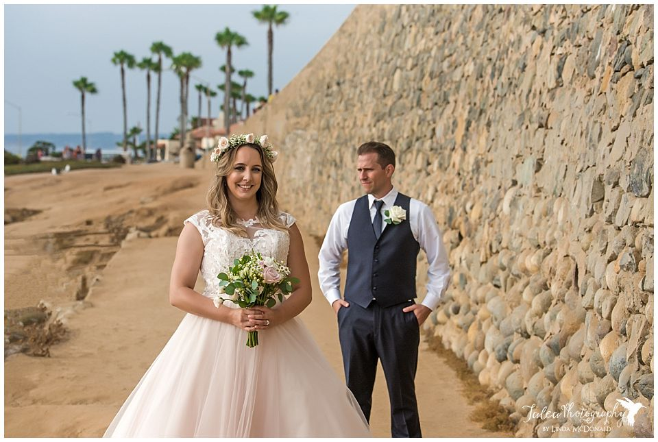 bride-posing-near-wall-wedding-bowl-la-jolla