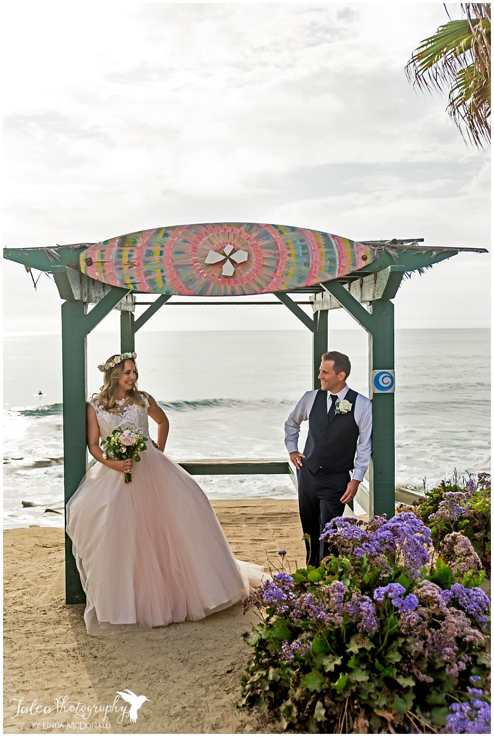 bride groom posing underneath beach structure cuvier park wedding