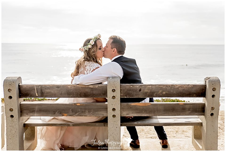 bride groom kissing on park bench cuvier park la jolla